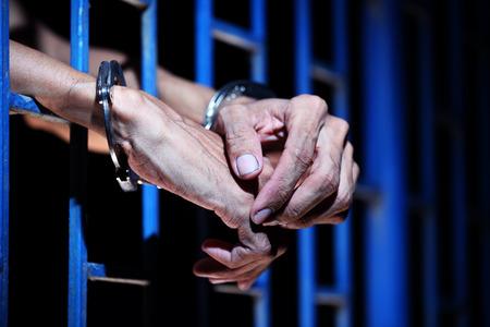 prisoner: prisoner hands in jail