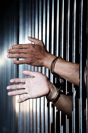 hand of prisoner in jail