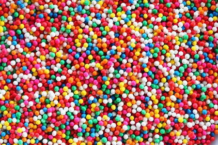 hundreds and thousands: colorful sugar sprinkles background.