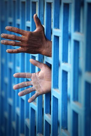 prisoner: hand of prisoner in jail