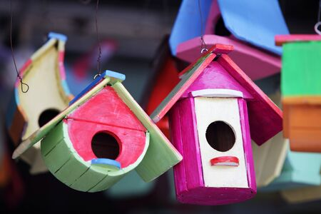 colorful wooden bird house as background. Stock Photo