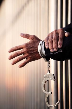 hand of businessman in jail as background with blur copyspace. Stock Photo