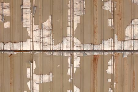 insulated: grunge peeling metallic insulated corrugate zinc roof texture as background. Stock Photo