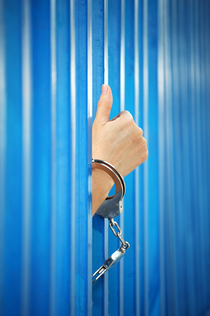 hand arrested by handcuff in jail