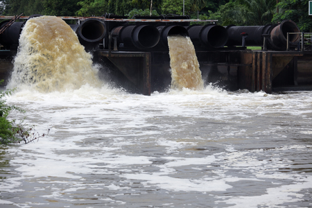 riverscape of large drainage steel pipe background.