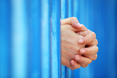 close up of woman's hand in jail background. Stock Photo - 90366486