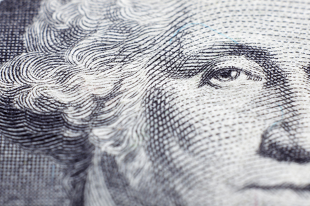 US president George Washington face portrait on the USA one dollar note with extreme macro, united states money closeup.