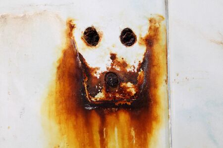 grunge abstract rusty skull sign on wall