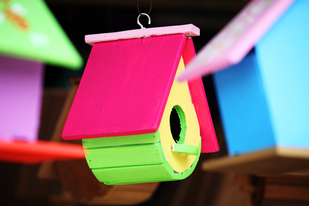 hanging colorful wooden bird house 스톡 콘텐츠