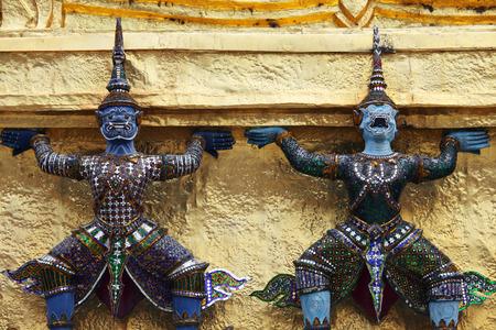 demon statue which support golden chedi at wat phra kaew bangkok,THAILAND. Banco de Imagens