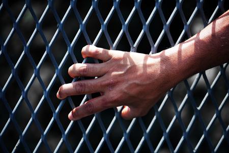 close up of hand in jail background. Standard-Bild - 117629588