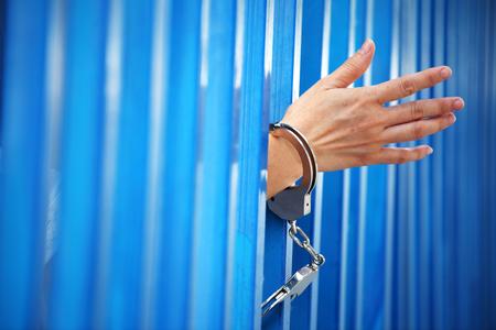 close up of hand in jail background. Standard-Bild - 118718192