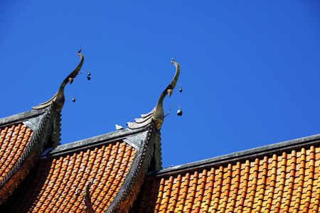 tradition thai temple roof architecture against blue sky