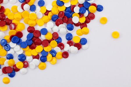 colorful industrial plastic pellets on white background