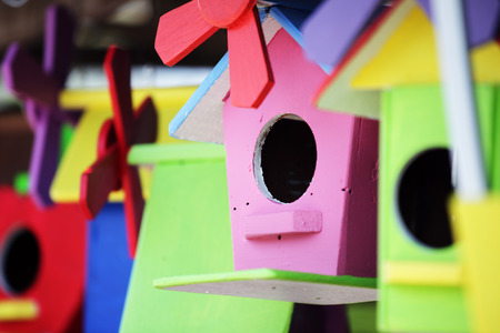 colorful wooden birdhouse background Stockfoto