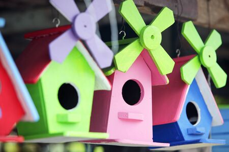 colorful wooden bird house background. Imagens