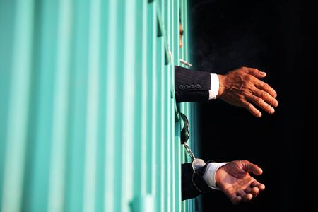 close up of businessman in jail background