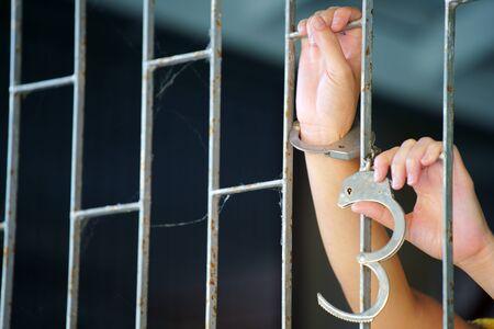 close up of prisoner hands in jail