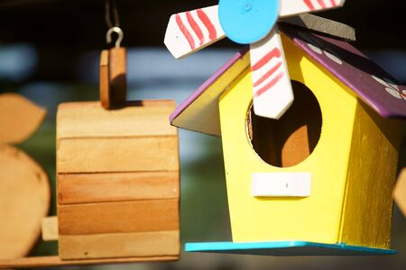 close up of beautiful colored wooden bird house Stockfoto