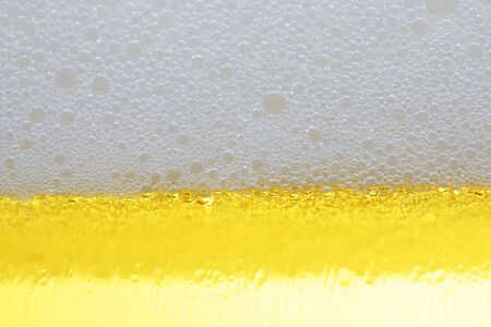 close up of cold larger beer in glass