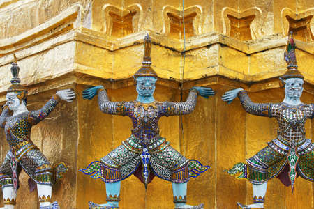 colorful tradition demon statue which support golden pagoda in grand royal palace,wat Pra Kaew Bangkok,thailand.