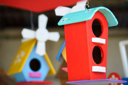 colorful wooden bird houses craft handmade Stock Photo