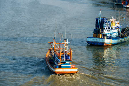 Riverscape of pattani with port of tradition fish ship along the river,capital business is fishering industry in  pattani province, THAILAND Stock Photo