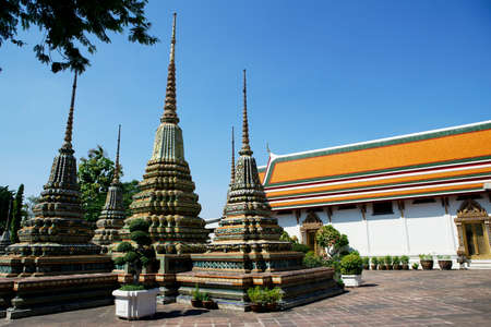 Wat Pho Temple in Bangkok, landmark temple with pagoda in the blue sky  historic religion Thai Culture day time