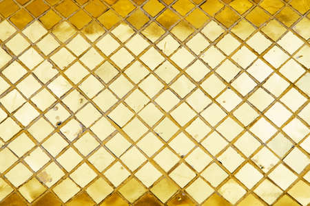 Gold tiles reflection background of retro thai culture shot from Pagoda from The Temple of the Emerald Buddha in Bangkok Thailand