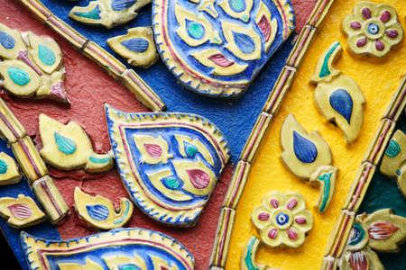 colorful stucco ancient building wall texture pattern at wat phra kaew temple royal palace,BANGKOK THAILAND. Stock Photo