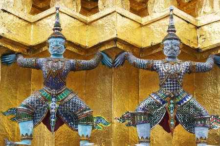 tradition demon statue which support golden pagoda at bangkok grand royal palace,thailand