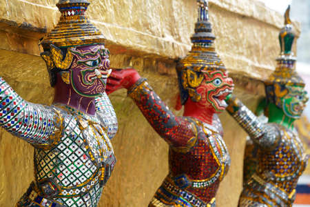 colorful tradition demon statue which support golden pagoda Stock Photo