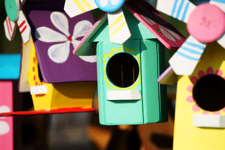 colorful manmade wooden bird house
