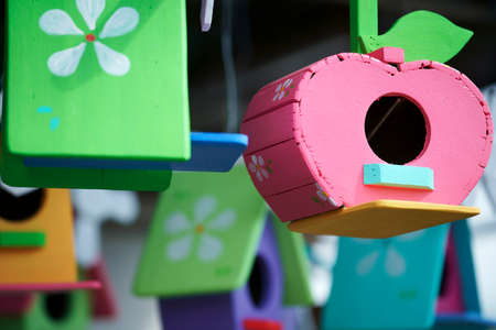 The birdhouse is made of colorful and painted wooden hanging beautiful. Stock Photo