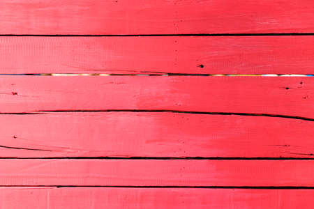 grunge crimson red wooden panel wall background Stock Photo