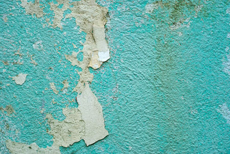 Peeling paint on old colorful wall background Stock Photo