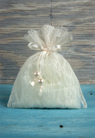 wedding favor: Wedding favor on old wooden table Stock Photo
