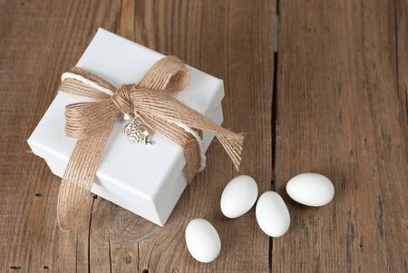 Wedding favor on old wooden table Stock Photo