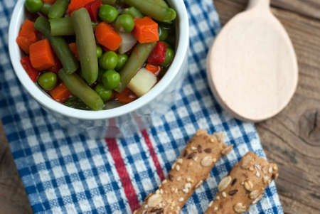 breadstick: Vegetable soup on old wooden table Stock Photo