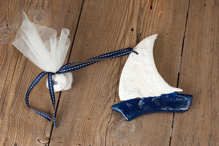 sugarplum: Wedding favor christening shaped boat on old wooden table