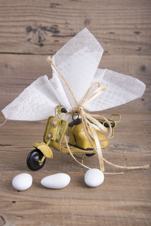 favor: Scooter toy wedding favor christening on old wooden table
