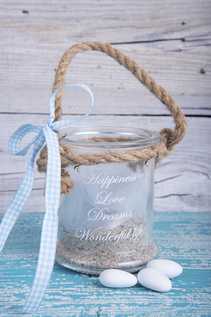favor: Glass jar wedding favor christening on old wooden table
