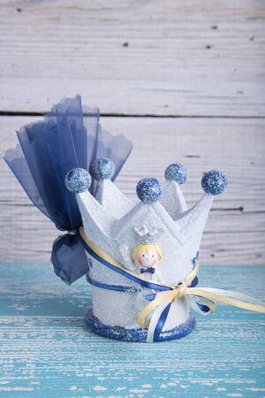 favor: King crown toy wedding favor christening on old wooden table