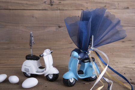 vespa: Ceramic motorbike wedding favor christening on old wooden table