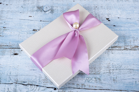 christmas bonus: Gift box with ribbon on old wooden table