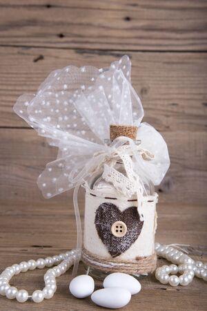 closed corks: Glass bottle wedding favor christening on old wooden table