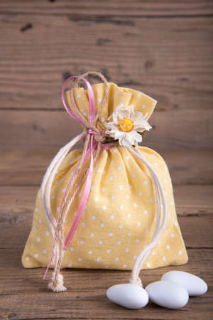 favor: Fabric pouch wedding favor on old wooden table