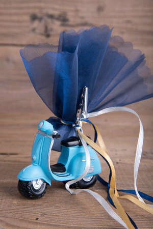 favor: Ceramic motorbike wedding favor christening on old wooden table