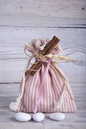 pouch: Fabric pouch wedding favor on old wooden table