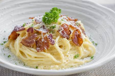 Classic Homemade Pasta Carbonara Italian. Spaghetti with bacon, eggs, parsel and parmesan cheese. Pasta Carbonara on white plate Stock Photo